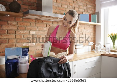 Preparing gym bag at home  - stock photo