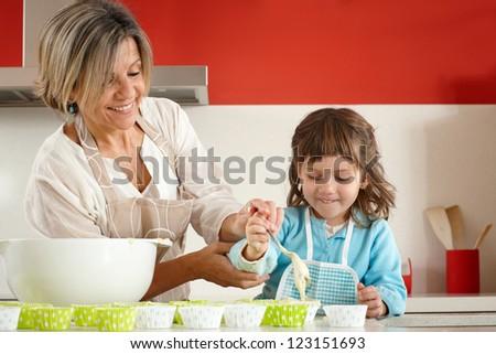 Preparing homemade muffins and cupcakes - stock photo