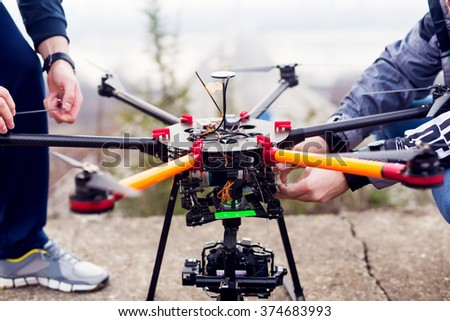 Preparing the drone for takeoff. - stock photo