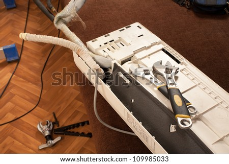 preparing to install new air conditioner. drilling the wall. - stock photo