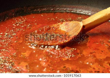 preparing tomato sauce for pizza and spaghetti - stock photo