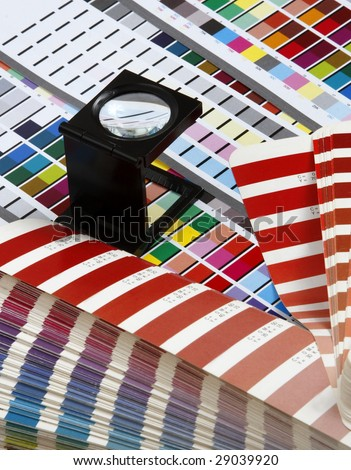 Prepress color management in print production. CMYK color check on printed paper. Quality printing concept - stock photo