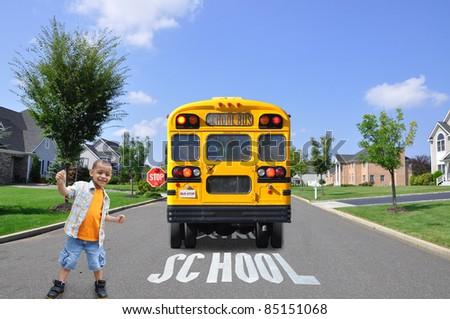 Preschool Age Boy Cheering School Bus Stopped - stock photo
