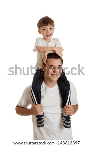Preschool aged boy riding on teen boy's shoulders isolated on white background - stock photo