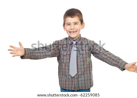 Preschool child laughing and standing with arms open ready  for hug isolated on white background - stock photo