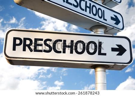 Preschool direction sign on sky background - stock photo