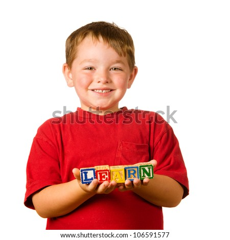 """Preschool education concept with child holding blocks that spell out """"learn"""" - stock photo"""