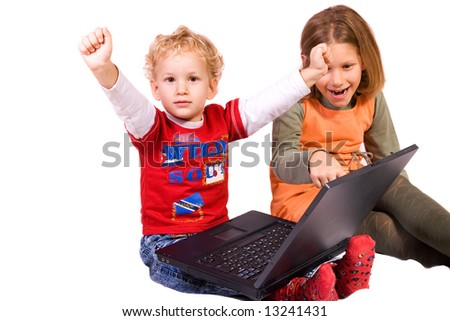 preschooler and schoolgirl playing games on notebook, isolated on white background - stock photo