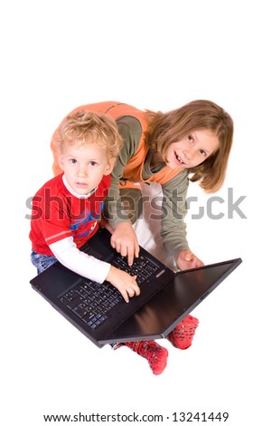 preschooler and schoolgirl working on notebook, isolated on white background - stock photo