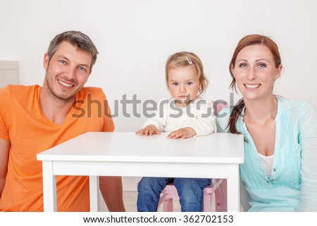 prescool teaching parents with daughter - stock photo