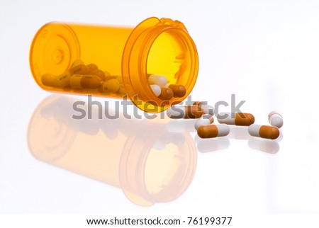 Prescription Drugs Spilling from Container - stock photo