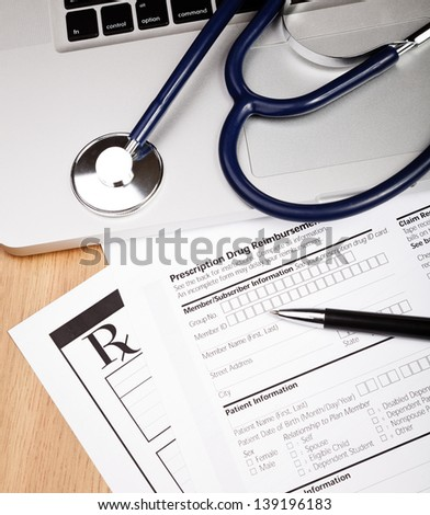 Prescription form with  pen stethoscope and laptop computer - stock photo