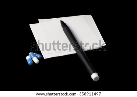 prescription, pills and pen on a black background - stock photo