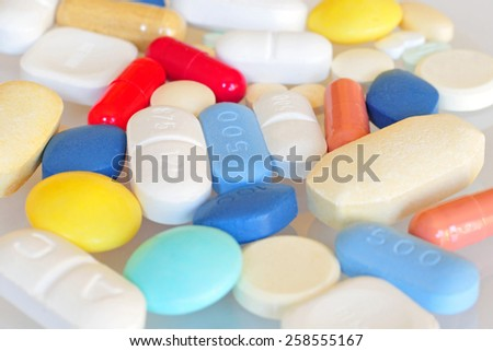 Prescription pills, close-up, shallow DOF - stock photo