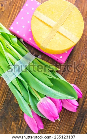 present and tulips - stock photo