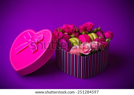 present box heart shape with flowers and macaroons violet background for valentines mother woman day easter with love - stock photo