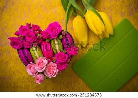 present box heart shape with flowers tulips macaroons and tablet yellow background for valentines mother woman day easter with love - stock photo