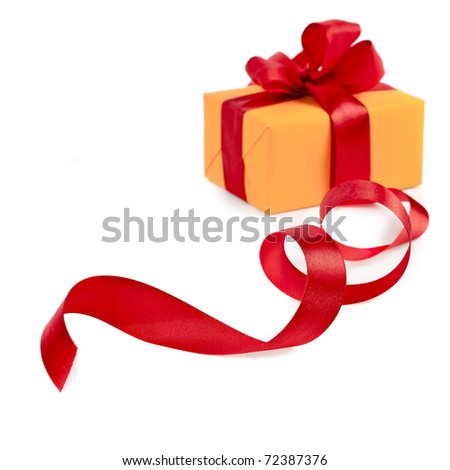 present box with red ribbon isolated on a white - stock photo