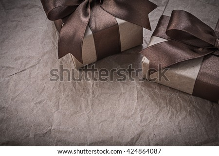 Present boxes with bow on wrapping paper celebrations concept. - stock photo