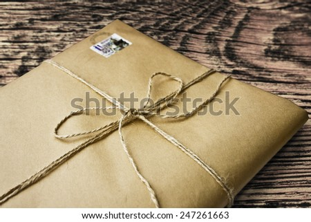 present gift from grunge paper - stock photo