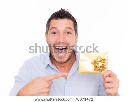Present gift holding man looking camera - stock photo