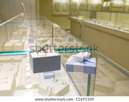 Present gift in jewerly shop - stock photo