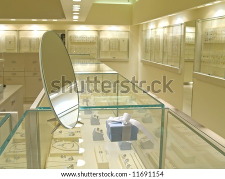 Present gift in jewerly shop. Blue box for jewerly near the mirror - stock photo