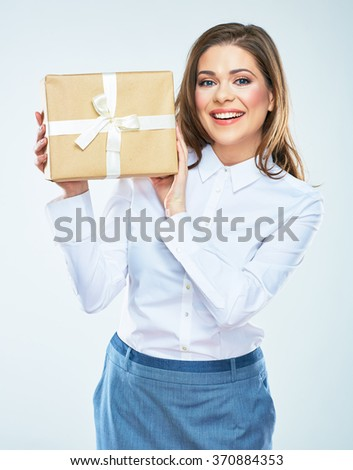 Present. White background isolated portrait of smiling woman with trendy gift box. - stock photo