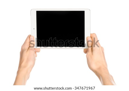 Presentation and advertising touchscreen topic: human hand holding a white tablet touch computer gadget with touch blank black screen isolated on a white background in the studio, first-person view - stock photo