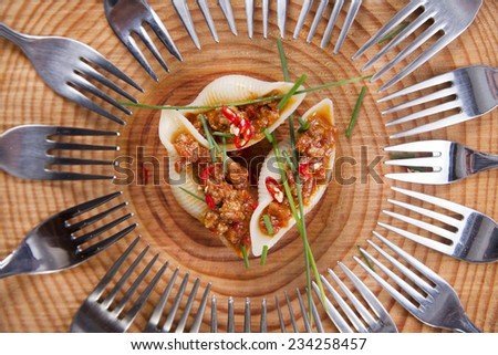 Presentation first plate of pasta shells with meat sauce and tomato - stock photo