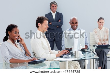 Presentation of a business team working hard  in the office - stock photo