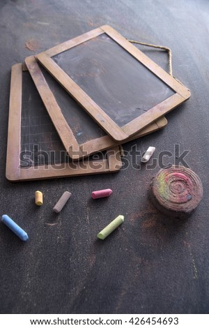 Presentation of small antique school blackboards of the past with chalk and selvedge - stock photo