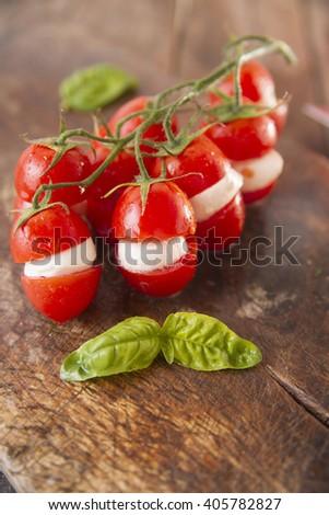 Presentation of the dish of the summer season, fresh tomato and mozzarella - stock photo