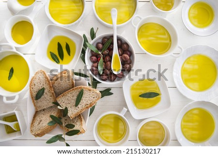 Presentation of wholemeal bread and olives with olive oil  - stock photo