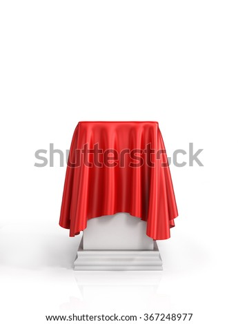 Presentation pedestal covered with a red silk cloth on white background. - stock photo