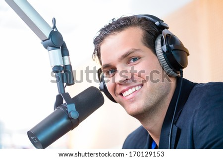 Presenter or host in radio station hosting show for radio live in Studio - stock photo