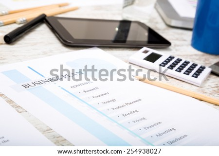 Presenting a Business Plan with a strategy to develop  - stock photo