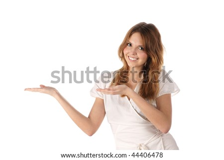 Presenting things. Portrait of young woman on white background - stock photo