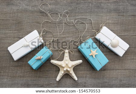 Presents decorated with shells - stock photo
