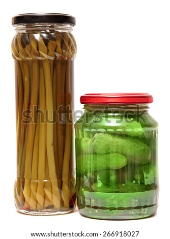 Preserved food in glass jars, isolated on white background. Various marinaded food , Wild garlic, cucumbers - stock photo