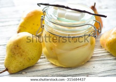 Preserved fruit.Homemade pears compote  - stock photo