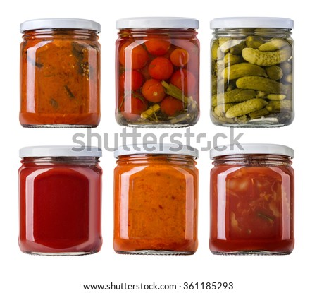 Preserved, pickled vegetables and food ingredients  in glass jars - stock photo