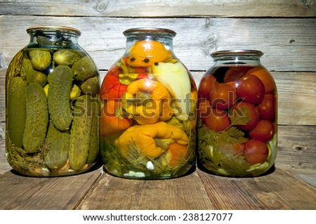 Preserved  vegetables on wooden background.Marinated food. - stock photo