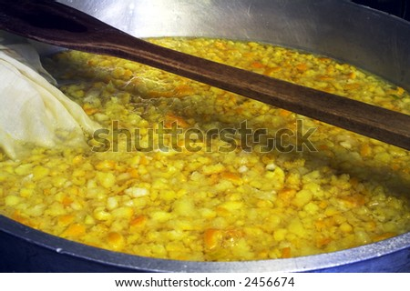 Preserving pan full of fruit, oranges, lemons & limes in the production of home-made marmalade - stock photo