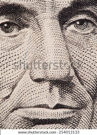 President Abraham Lincoln face on us 5 dollar bill super macro, USA money closeup  - stock photo