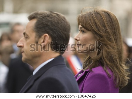 President Nicolas Sarkozy of France and his wife Carla Bruni-Sarkozy attend the laying of a wreath at the Statue Of Charles De Gaulle on March 27, 2008 in London, England. - stock photo