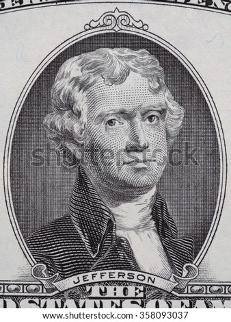 President Thomas Jefferson face on us two dollar bill macro, united states money closeup - stock photo