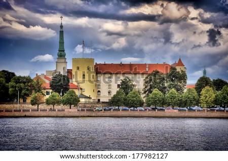 presidential Palace. Old Riga across blue Daugava. Latvia - stock photo