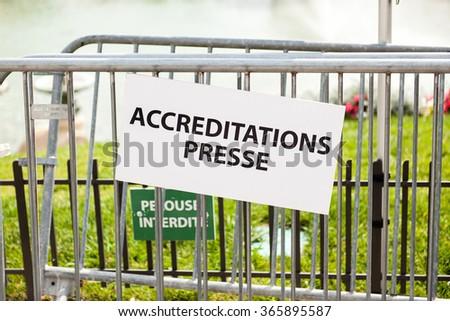Press accreditation dedicated area near a metallic fence - stock photo