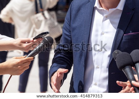Press interview with politician, businessperson or spokesperson - stock photo